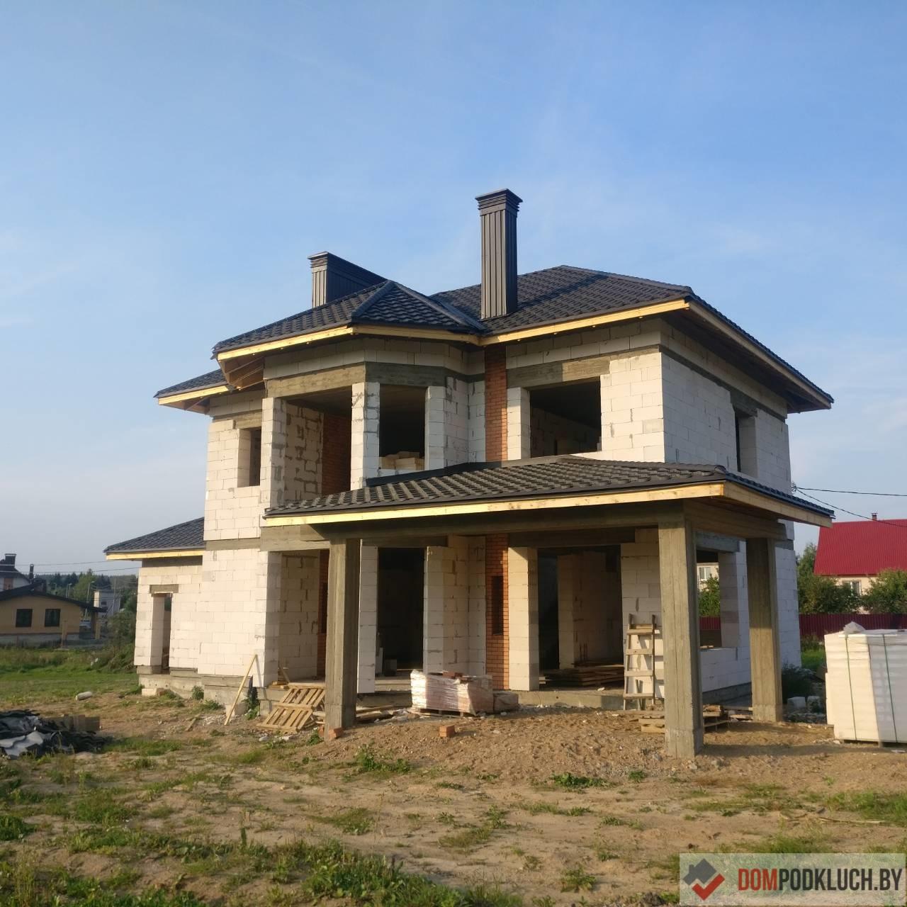 Построенный двухэтажный дом без отделки